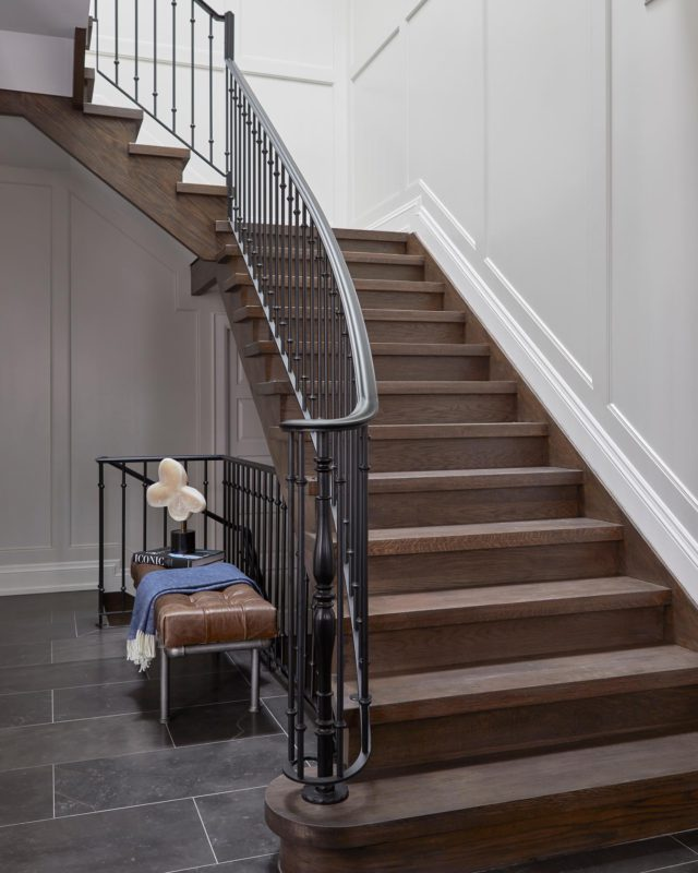 """This staircase embodies the elegance and history of an old-world style home. We gave this staircase some dramatic flair with black steel handrails and bannisters for a continuous visual statement.  To give this space an opulent look we installed high-quality detailed millwork and crown moulding that was carried over onto the top floor! ⠀ ⠀⠀ If you're in need of inspiration for your staircase renovations. Take a look under the """"Staircase Reno"""" Instagram story highlight section. ⠀⠀ .⠀⠀ .⠀⠀ .⠀⠀ .⠀⠀ .⠀⠀ #dvirainteriors #luxurylifestyle #frontentry #frontentrance #interiorsofinstagram #staircaserenovation #homeremodel #home #interiorvibes #luxurydesign #luxuryinteriors #torontointeriors #designerofluxury #staircaserenovation #staircasereno #luxuryhomes #mansiondesign #interiors #interiordesign #mystylishspace #stairfloors #stairs #houseandgarden #homeinspiration #homerenovations #staircase"""
