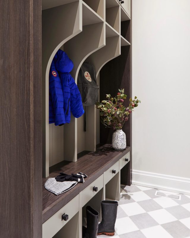 Keep the snow and salt out from the rest of the house by walking through a mudroom!   For this mudroom, we used a mix of timeless elements—classic bench with built-in shelves, checkered flooring, and plenty of storage in cabinets above —to create a room that will never go out of style! ⠀ The tall custom closet wall with a built-in bench has become the family's landing pad for sweaters and bags. The kids come through this hallway and toss everything on the bench! This room really is a functional and stylish space! ⠀   Here's why I'm a huge proponent of mudrooms 👇  ▪️They keep the mud and outdoor dirt out and will save you a lot of cash on cleaning costs.   ▪️Mudrooms cut down heating and air conditioning expenses. They are great buffers for keeping the summer heat away from the air-conditioned home.   ▪️Mudrooms are great places to drop your coats and bags and store extra goods.  . . . . . . . . . #closetfactorytampa #customclosetstampa #customshelves #homerenovation #homeremodeling  #entrywaydesign #entrywaydecor #entrywaybench #mudroomdesign #mudroommakeover #mudroombench #moodyinteriors #homesohard #modernfarmhousestyle #modernfarmhousedesign #doingneutralright #whiteandwood #mudroomstorage #mudroommakeover #mudroomdesign