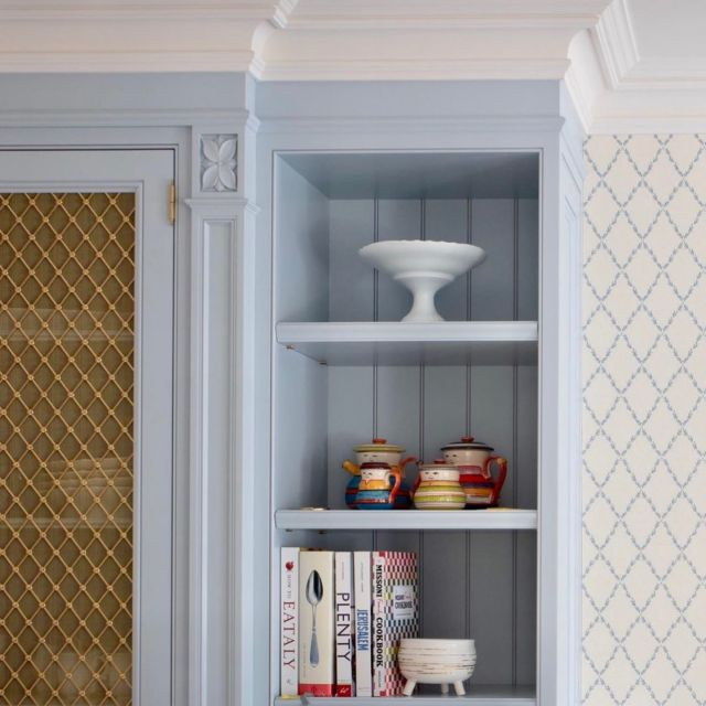 This custom pantry cabinet wall is part of the breakfast area that's just a few steps away from the kitchen. ⠀ ⠀ The design scheme of this custom pantry cabinets carries over from the style of the custom kitchen that consisted of light blue, white, gold and stone elements!⠀ ⠀ The closed cabinet door was decorated with a gold metal mesh, this detail creates an artful look and stylishly hides the plates and glasses. In contrast, the open cabinets give space to reveal unique collectables and the owners favourite cooking books! ⠀ .⠀ .⠀ .⠀ .⠀ .⠀ .⠀ #dvirainteriors #torontohome #torontointeriors #frenchkitchen #frenchstyle #kitchenpantry #bluekitchen #parisiankitchen #frenchdesign #luxuryhome#interiordesign #dreamkitchen #designlover #customkitchen #goldkitchen #kitchendesign #kitchenideas #kitchenremodel #kitchensofinsta #kitchensofinstagram #kitcheninspiration #interiordesigner #kitchentrends #kitchengoals 