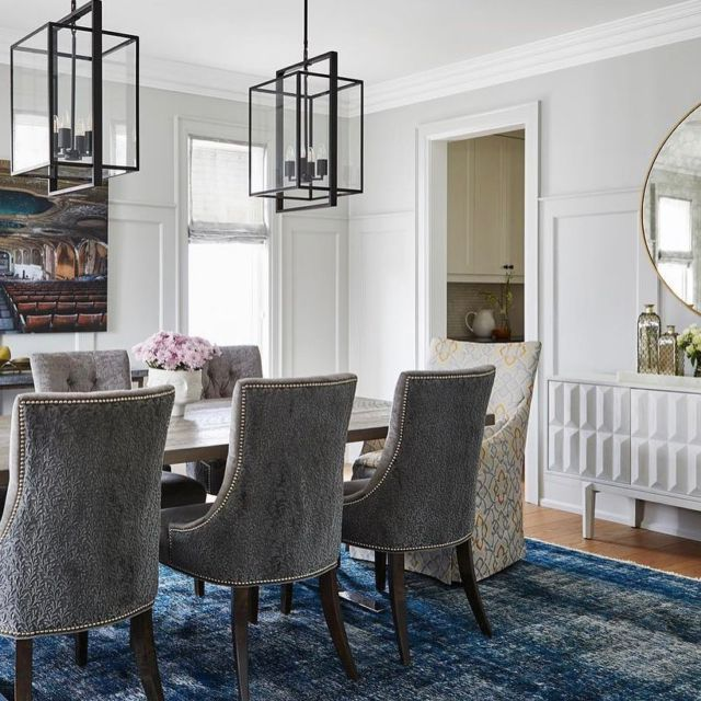 No matter your design style, there's dining room decor to suit your taste. From modern elegance, contemporary, antiques to taking design risks with bold wallpapers and furniture. There's something for everyone!   To give this room a contemporary upgrade we anchored it with a blue rug, wooden table and contemporary grey velvet chairs.  ⠀ . . .⠀ .⠀ .⠀ .⠀ .⠀ #dvirainteriors #athomewithdvira  #torontodesigner #myhome #torontohome  #modernupgrade #moderndesign #wainscotting #modernrenovation #contemporaryhome #torontomodernhome #boxwindow #contemporarydesign #designerfurniture #diningroomstyle #luxuryhomes #modernhome #inspiringinteriors #torontodesign #contemporarydiningroom #bluediningroom #diningroominspo