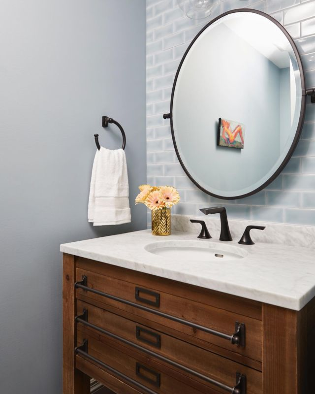 Light blues reign in this basment bathroom from project Armour  Subway tiles are a timeless material that look good in so many spaces and with every design style!  The subway tile was birthed in New York City, more specifically by designers George C. Heins and Christopher Grant La Farge. They were first seen in a New York subway station, and due to their sleek and easy to clean design, quickly made their way into kitchens and bathrooms across the United States! Subway tiles are here to stay and a classic design staple. They come in a variety of materials including marble, glass, ceramic, slate and porcelain. Traditionally, subway tile is 3 x 6 inches. However, sizes for subway tile have expanded to include many other sizes.  ⠀ If you could pick a subway tile material for your bathroom, what would it be? ⠀  Project- Armour To view more photos from this project visit our website www.dvira.com  . . . . . . #dvirainteriors #bathroomdesign #masterbathroom #bathroomdesign #bathroomreno #luxuriousbathrooms #stonewall #uxury #stonetile  #luxuriousbathroom #naturalstone #bathroominspo #mainbathroom #subwaytiles #bathroomgoals #bathroomideas #bathroommakeover #ensuitebathroom #whitebathroom⠀ #bathroomremodel#masterbath #powderroom #bathroominspo #bathroomgoals #customhome #bathroomideas #bathroomsofinsta #bathroomdecor ⠀