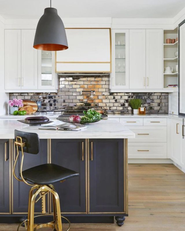 The kitchen is not just the family hang out space where you cook up food and good times, it's also THE place to entertain and kick back in a laid back atmosphere 😍  To add in some sparkle in this kitchen, we incorporated a shimmery bronze subway tile for the back-splash; its look changes depending on the light and angle.   The hood is a statement piece; it still feels very contemporary, but it also has classic styling. We treated the slightly curved range hood with the same metallic highlights, transforming the oven and hood range into a dramatic focal point!  Project- Blythwood  To view more photos from this project visit our website www.dvira.com/residential.html  This project was published in Home In Canada Magazine . . . . . . . . #kitcheninspo #torontohomes #architecture_hunter #classickitchen#stopandstaredecor #torontinteriordesign #kitcheninteriordesign #darkkitchen #ornatekitchen #bluehood #bluekitchenhood #mirroredtile #kitchencountertop #torontoliving #myhouseandhome #dream_interiors #modernluxury #torontohomes #beautifulkitchen #luxuryinterior #marblebacksplash #torontohome #boldkitchen #myhouseidea #luxurykitchen #passion4interior